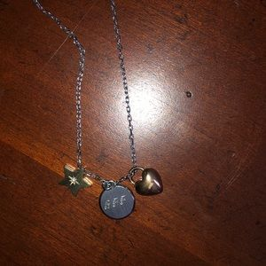 fossil necklace with 3 charms.